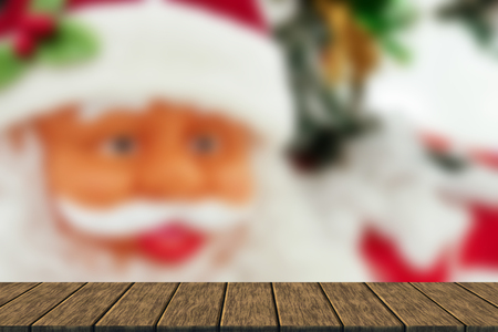 wood figurine: santa clause figurine statuette with christmas tree (blur background with wood table top for display or montage your product) Stock Photo