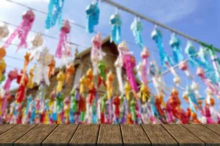 yeepeng: colorful paper lantern decoration for Yeepeng festival at temple in Thailand (blur background with wood table top for display or montage your product)