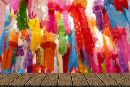 yeepeng: colorful paper lantern decoration for traditional Yeepeng festival in Thailand (blur background with wood table top for display or montage your product)