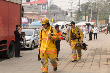 responding: Chiang Mai, Thailand - March 25, 2016: firefighter in mock disaster drill at Maya shopping center in Chiang Mai, Thailand on March 25, 2016.