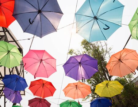 colourful sky: colorful umbrella hanging on the rope for decoration Stock Photo