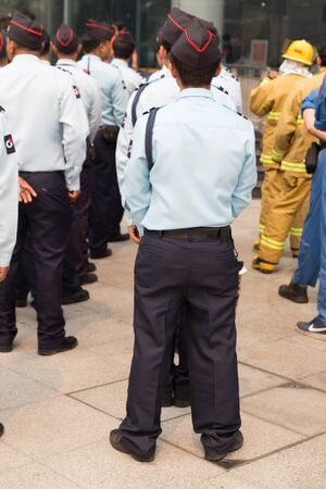 responding: Chiang Mai, Thailand - March 25, 2016: security guard in mock disaster drill at Maya shopping center in Chiang Mai, Thailand on March 25, 2016. Editorial