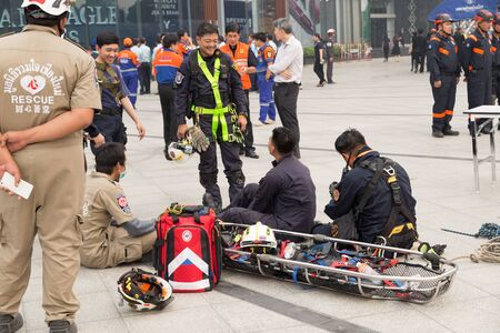 gurney: Chiang Mai, Thailand - March 25, 2016: Paramedic and stretcher gurney in mock disaster drill at Maya shopping center in Chiang Mai, Thailand on March 25, 2016.