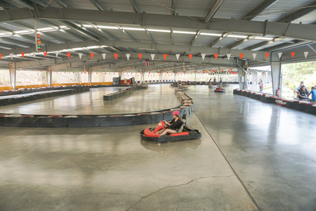 thrilling: Chiang Mai, Thailand - March 26 2016: People drive indoor drifter go-cart at X centre which is the one-stop for all adrenaline junkies with a wide range of thrilling activites in Chiang Mai, Thailand on March 26, 2016. Editorial