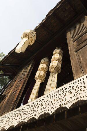 lanna: white lanna paper lantern decorating  on wooden ancient lanna house