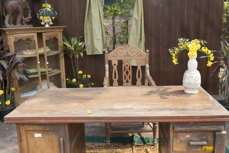 antique chair: antique wooden chair and table at patio