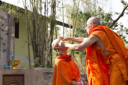 ordination: Chiang Mai, Thailand - April 30, 2016: monk shave mans hair before buddhist monk ordination ceremony at Umong temple in Chiang Mai, Thailand on April 30, 2016.