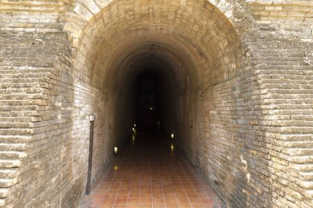go inside: walkway to go inside of cave tunnel Stock Photo