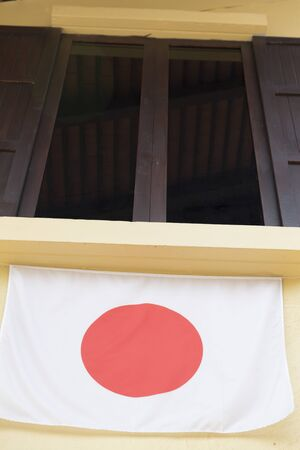 tinted glasses: brown wooden window with tinted glass decorating with japan national flag