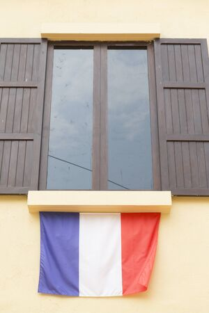 tinted glasses: brown wooden window with tinted glass decorating with france national flag Stock Photo