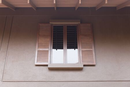 tinted: brown wooden window with tinted glass Stock Photo