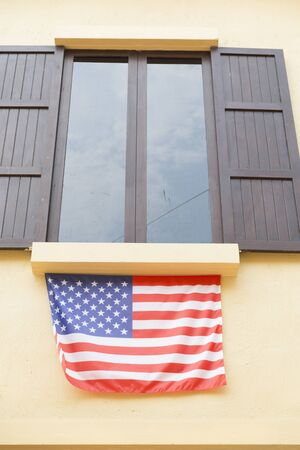 tinted: brown wooden window and tinted glass decorating with united states national flag