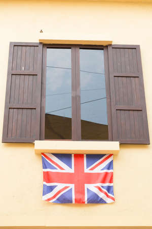 tinted: brown wooden window and tinted glass decorating with united kingdom national flag Stock Photo