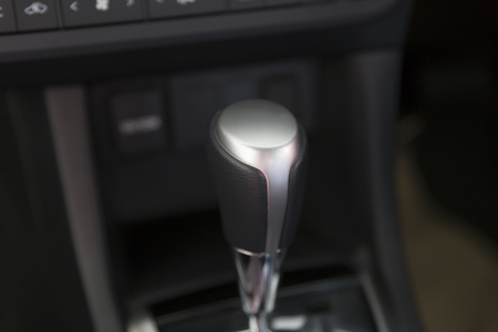 gearstick: automatic gearstick inside of new car automobile