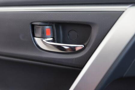 door handle: chrome door handle inside of new car Stock Photo