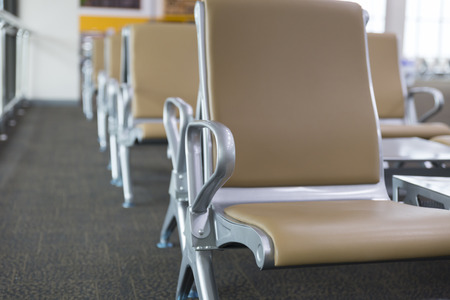 leather chair: brown leather chair in airport terminal building