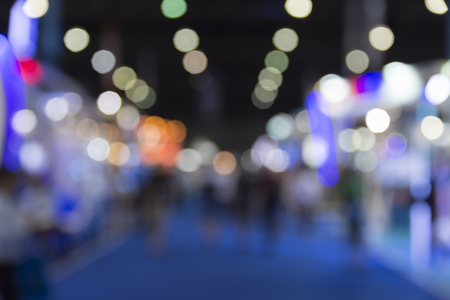 tradeshow: people in tradeshow exhibition hall building, blur background