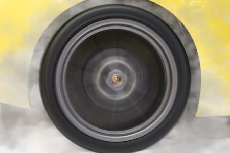 drifting: drifting wheel of new yellow sport car