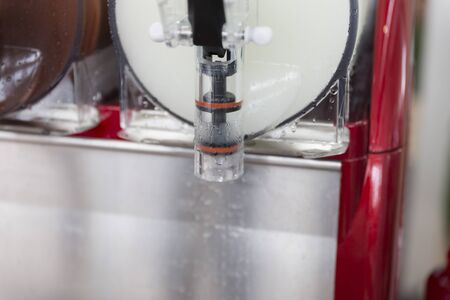 granizados: cold ice slush fruit juice beverage equipment machine, selective focus