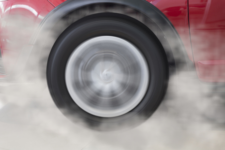drifting: drifting and smoking wheel tire of new red car automobile