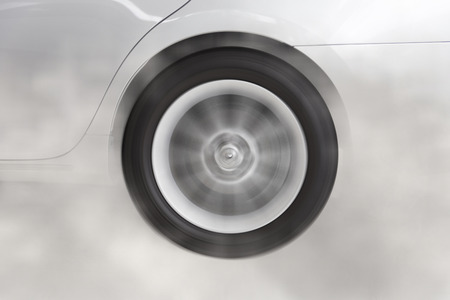 drifting: drifting and smoking wheel tire of new white car automobile