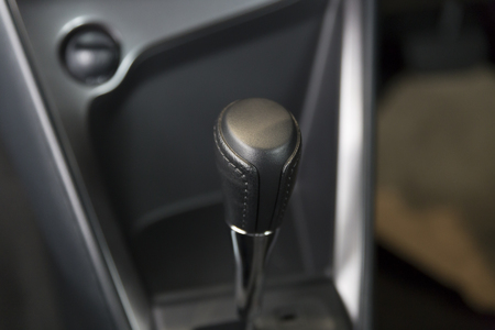 gearstick: automatic gearstick inside of new car automobile, selective focus