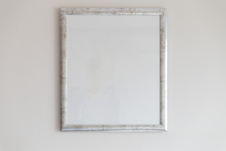 silver frame: silver picture frame decorating on white wall Stock Photo