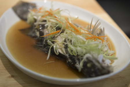 fish sauce: steamed sea bass fish with vegetable  and fish sauce