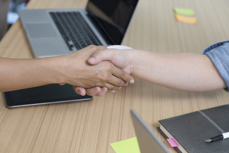 acquisitions: businesspeople handshaking for use as cooperation, acquisition, merger concept