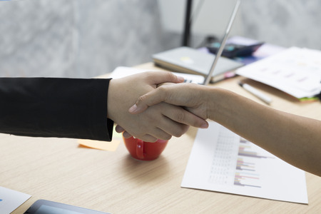 merger: businesspeople handshaking for use as cooperation, acquisition, merger concept