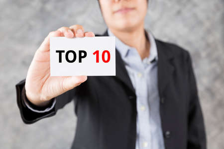 top 10: businessman showing business card with word top 10