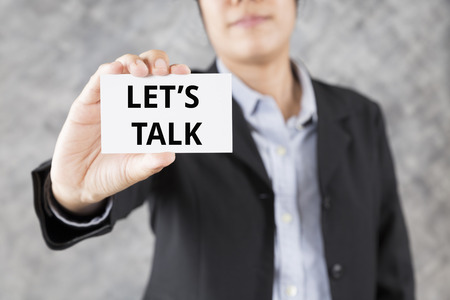 lets: businessman showing business card with word lets talk