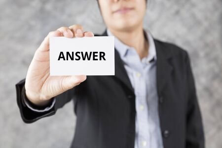 answer: businessman showing business card with word answer Stock Photo