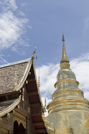 spiritual architecture: golden stupa pagoda and sanctuary in buddhism temple Stock Photo