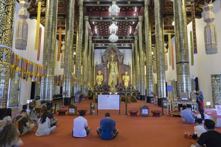 Chiang Mai, Thailand - June 19, 2016:  people listen to buddhist monk prayer at Chedi Luang temple in Chiang Mai, Thailand on June 19, 2016.