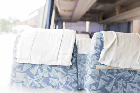 vehicle seat: blue fabric vehicle seat in interior mini bus