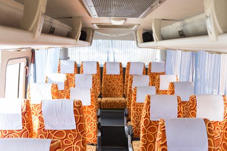 mini bus: orange fabric vehicle seat in interior mini bus