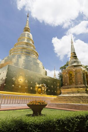 spiritual architecture: golden stupa pagoda in buddhism temple