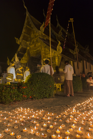 relic: Chiang Mai, Thailand - June 10, 2016: candle light to pay respect to buddha relic at buddhist temple at Tonkwen temple in Chiang Mai, Thailand on June 10, 2016.