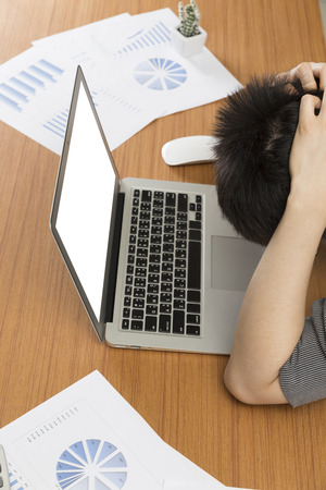 frustrate: man with laptop computer on office desk - frustrate, stress, upset concept Stock Photo