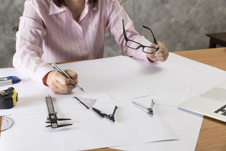 construction project: architect working on construction engineering project blueprint Stock Photo
