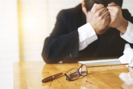 frustrate: businessman with hand on head in office - upset, frustrate, stress concep t- blur for use as background Stock Photo
