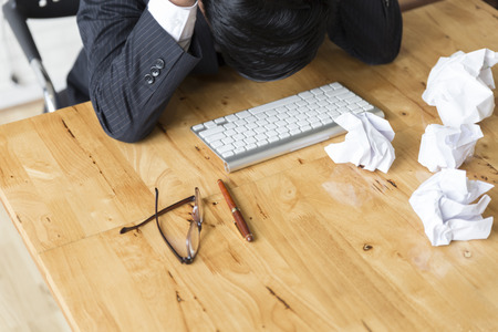 frustrate: businessman with hand on head in office - upset, frustrate, stress concept