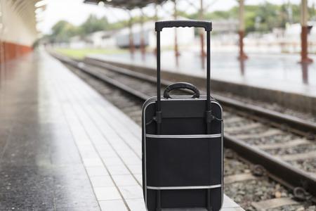 baggage train: black baggage bag on platform at train station  - travel concept Stock Photo