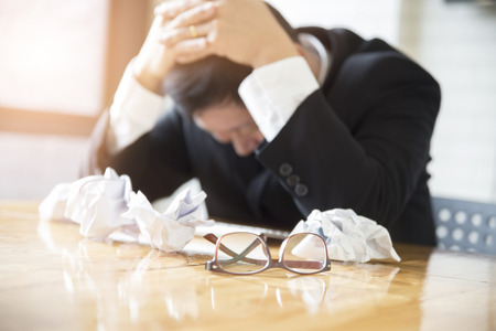 frustrate: businessman with hand on head in office - upset, frustrate, stress concept - blur for use as background
