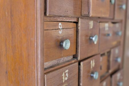 drawer: wooden drawer of old cabinet with number