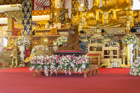 preachment: Chiang Mai, Thailand - August 28, 2016: buddhist monk sit in church before preachment at Suandok temple Editorial