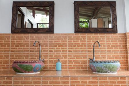 washbowl: sculpture washbowl or wash basin and faucet Stock Photo