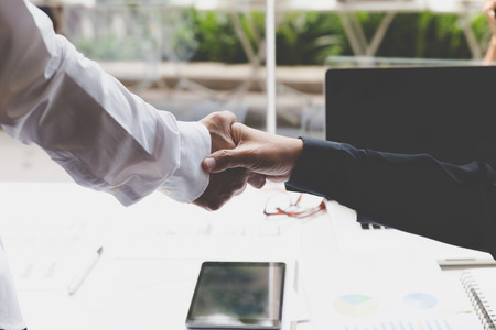 acquisition: businessman handshaking in office - teamwork, cooperation, agreement, acquisition concept Stock Photo