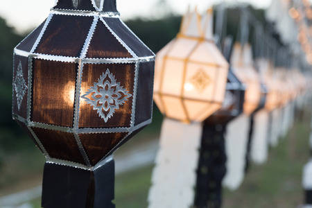 black and white festive hanging paper lantern decoratiing in park